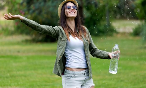 Portrait of beautiful young woman enjoying summer with water.
